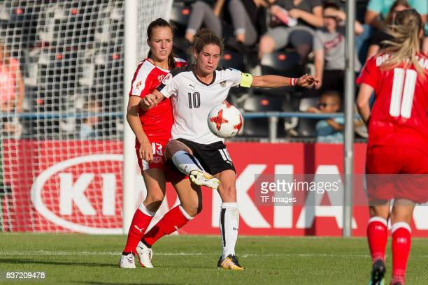 Lia Waelti of Switzerland and Nina Burger of Austria battle for the ball during the Group C match between Austria and Switzerland during the UEFA...