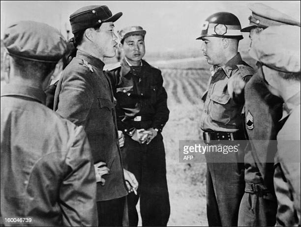 A US liaison officer argues with a North Korean counterpart in April 1953 at the crossing point in the truce village of Panmunjom as the armistice...