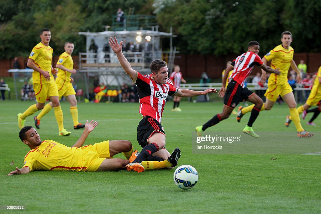 Liam Agnew of Sunderland (C) goes over after atackle during the Barclays U21 Premier League match between Sunderland U21 and Liverpool U21 at Eppleton Colliery Welfare ground on August 19, 2014 in Hetton Le Hole, England.