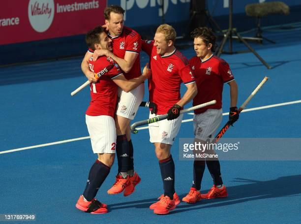 Liam Ansell of Great Britain celebrates scoring their team's first goal with team mates Chris Griffiths, Rupert Shipperley and James Gall during the...
