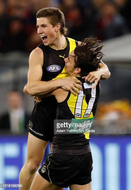 Liam Baker of the Tigers celebrates his first AFL goal with Daniel Rioli of the Tigers during the 2018 AFL round 22 match between the Richmond Tigers...