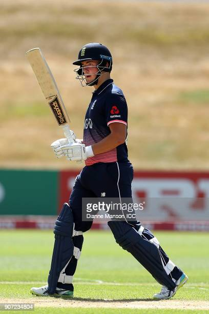Liam Banks of England celebrates his half century during the ICC U19 Cricket World Cup match between England and Canada at John Davies Oval on...