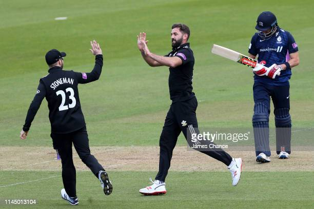 Liam Blunkett of Surrey celebrates dismissing Stephen Esknazi of Middlesex with Mark Stoneman of Surrey during the Royal London One Day Cup match...
