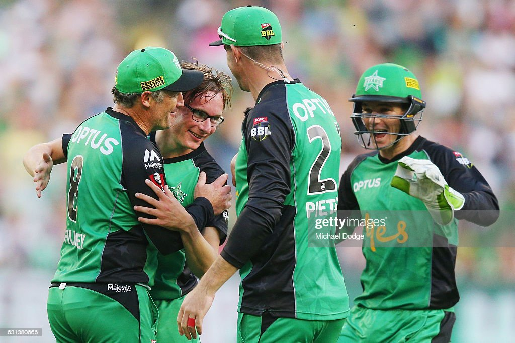 Liam Bowe of the Stars (2nd left) celebrates a wicket with David Hussey during the Big Bash League match between the Melbourne Stars and the Adelaide Strikers at Melbourne Cricket Ground on January 10, 2017 in Melbourne, Australia.