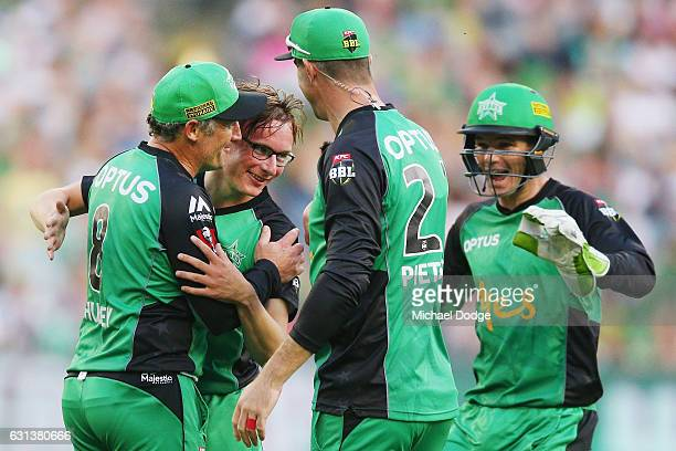 Liam Bowe of the Stars celebrates a wicket with David Hussey during the Big Bash League match between the Melbourne Stars and the Adelaide Strikers...