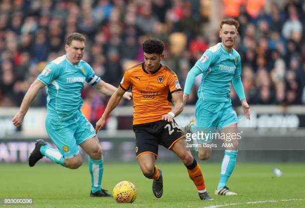 Liam Boyce and Tom Naylor of Burton Albion and Morgan GibbsWhite of Wolverhampton Wanderers during the Sky Bet Championship match between...