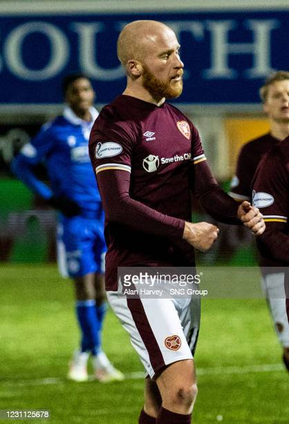 Liam Boyce celebrates his late equaliser for Hearts during a Scottish Championship match between Queen of the South and Heart of Midlothian at...