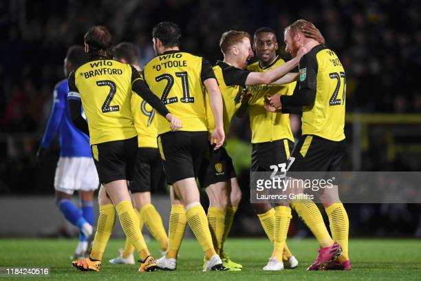 Liam Boyce of Burton Albion celebrates with teammates after scoring his team's first goal during the Carabao Cup Round of 16 match between Burton...