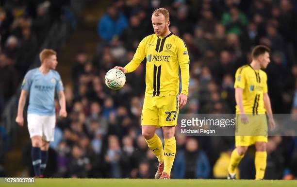Liam Boyce of Burton Albion looks dejected during the Carabao Cup Semi Final First Leg match between Manchester City and Burton Albion at Etihad...