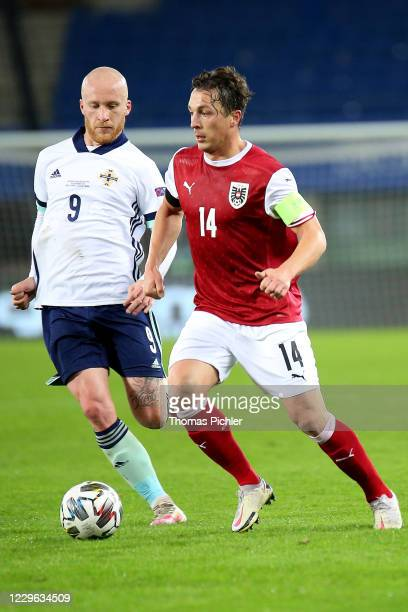 Liam Boyce of Northern Ireland and Julian Baumgartlinger of Austria during the UEFA Nations League between Austria and Northern Ireland at the Ernst...