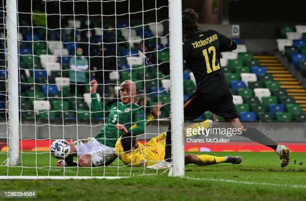 Liam Boyce of Northern Ireland scores their team's first goal during the UEFA Nations League group stage match between Northern Ireland and Romania...
