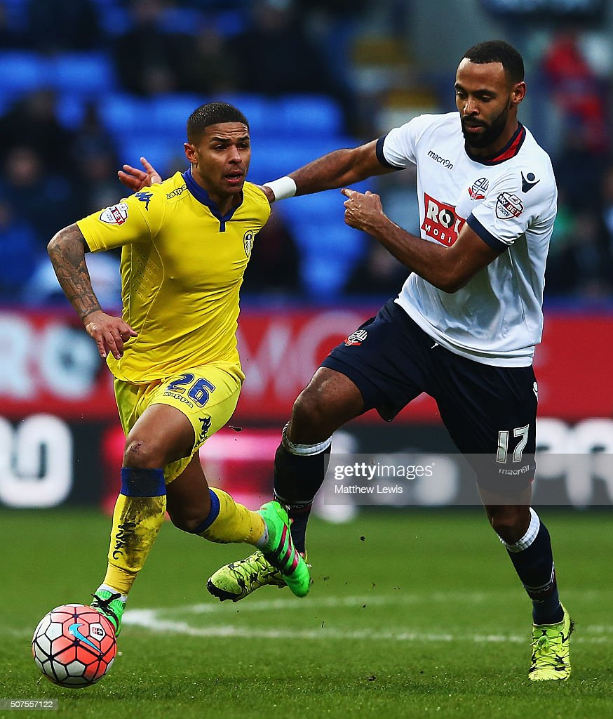 Liam Bridcott of Leeds and Liam Trotter of Bolton Wanderers challenge for the ball during The Emirates FA Cup Fourth Round match between Bolton Wanderers v Leeds United at Macron Stadium on January 30, 2016 in Bolton, England.