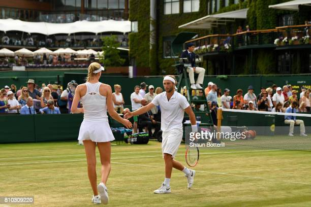 Liam Broady and Naomi Broady of Great Britain in discussion during the Mixed Doubles first round match against Wesley Koolhof of the Netherlands and...