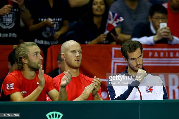 Liam Broady Dominic Inglot of Great Britain and Andy Murray of Great Britain watch Dan Evans of Great Britain during his singles match against...