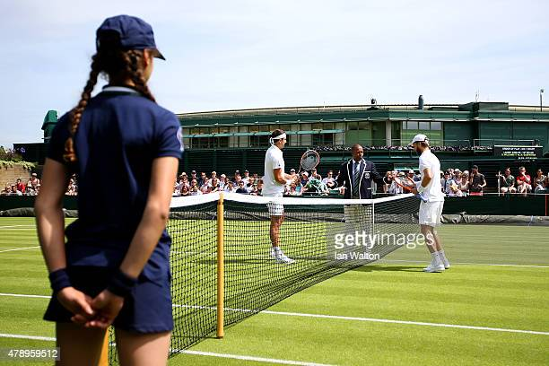 Liam Broady of Great Britain and Marinko Matosevic of Australia prepare to play their Gentlemen's Singles match during day one of the Wimbledon Lawn...