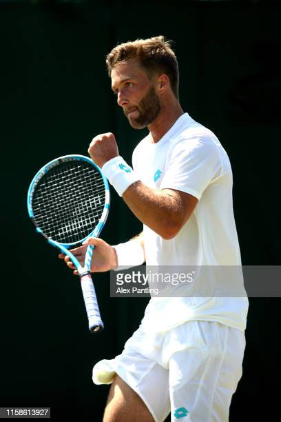 Liam Broady of Great Britain celebrates during his mens singles match against Gregorie Barrere of France during qualifying prior to The Championships...