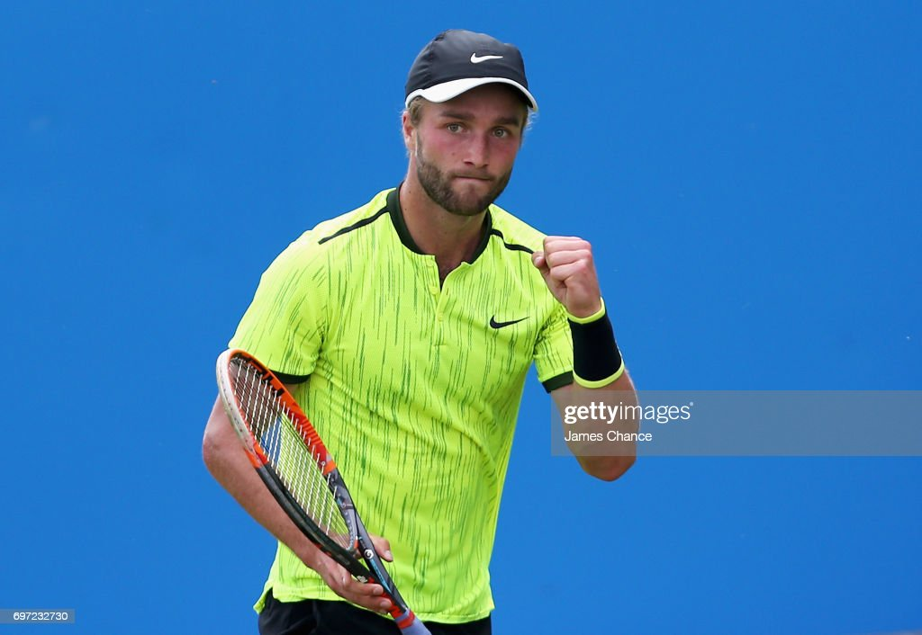 Liam Broady of Great Britain celebrates during the qualifying match against Denis Shapovalov of Canada ahead of the Aegon Championships at Queens Club on June 18, 2017 in London, England.