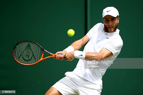 Liam Broady of Great Britain in action against Marinko Matosevic of Australia in their Gentlemen's Singles match during day one of the Wimbledon Lawn...
