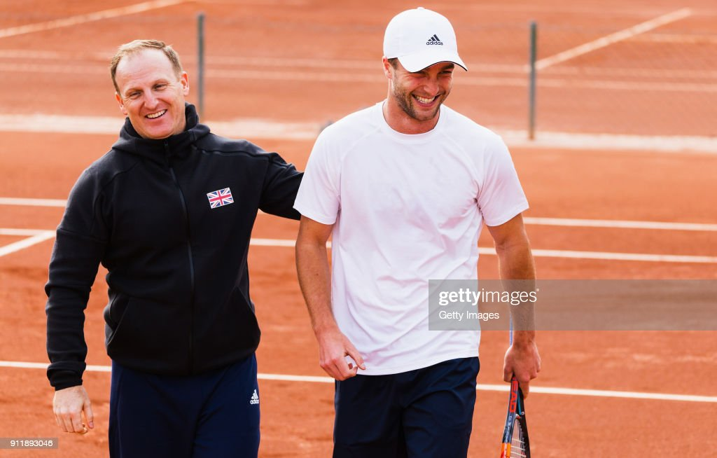 Liam Broady (R) of Great Britain laughs with Matt Little during practice ahead of the Davis Cup by BNP Paribas World Group First Round match between Spain and Great Britain on January 29, 2018 in Marbella, Spain.