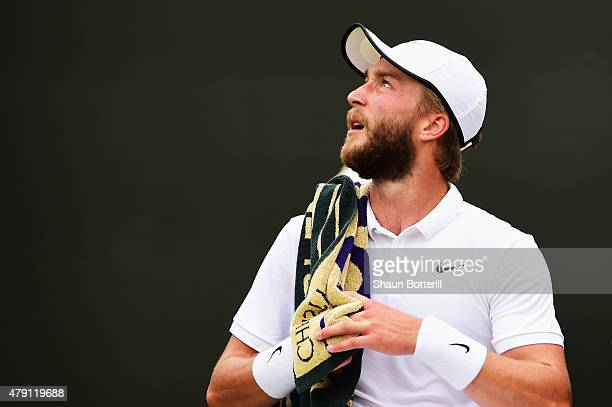 Liam Broady of Great Britain looks on in his Gentlemens Singles Second Round match against David Goffin of Belgium during day three of the Wimbledon...