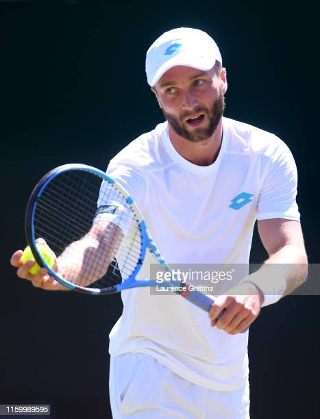 Liam Broady of Great Britain partner of Scott Clayton of Great Britain in their Men's Doubles first round match against Nicolas Mahut of France...