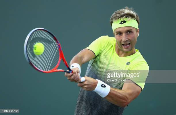 Liam Broady of Great Britain plays a backhand against Bjorn Fratangelo of the United States in their first round match during the Miami Open...