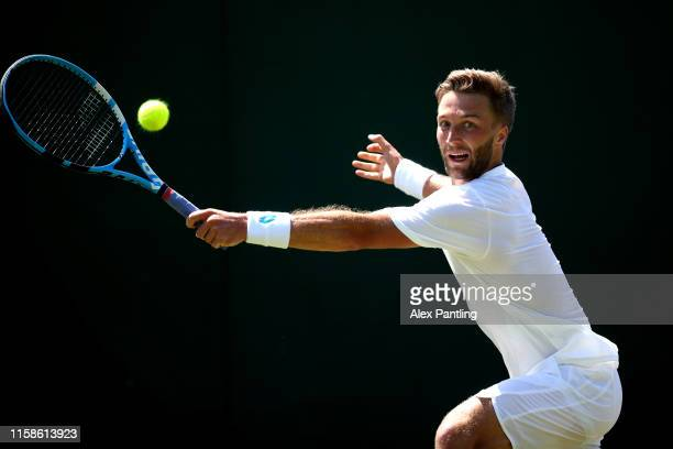 Liam Broady of Great Britain plays a backhand during his mens singles match against Gregorie Barrere of France during qualifying prior to The...