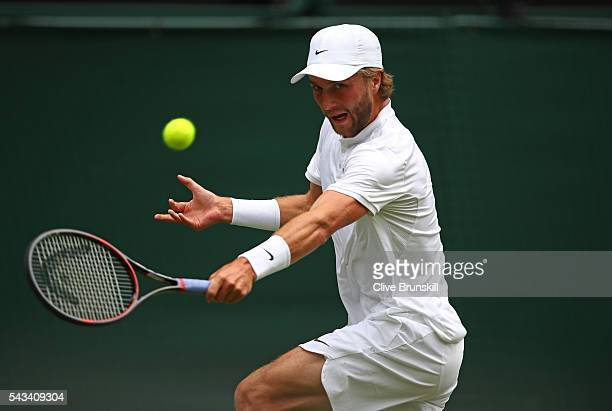 Liam Broady of Great Britain plays a backhand during the Men's Singles first round match against Andy Murray of Great Britain on day two of the...