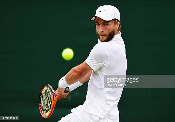 Liam Broady of Great Britain plays a backhand in his Gentlemens Singles Second Round match against David Goffin of Belgium during day three of the...