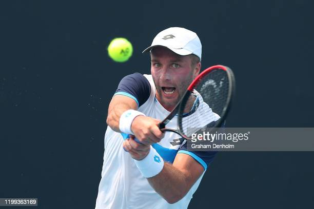 Liam Broady of Great Britain plays a backhand in his match against Ilya Ivashka of Belarus during 2020 Australian Open Qualifying at Melbourne Park...