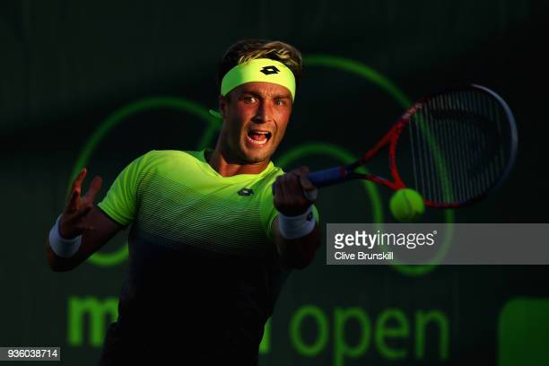 Liam Broady of Great Britain plays a forehand against Bjorn Fratangelo of the United States in their first round match during the Miami Open...