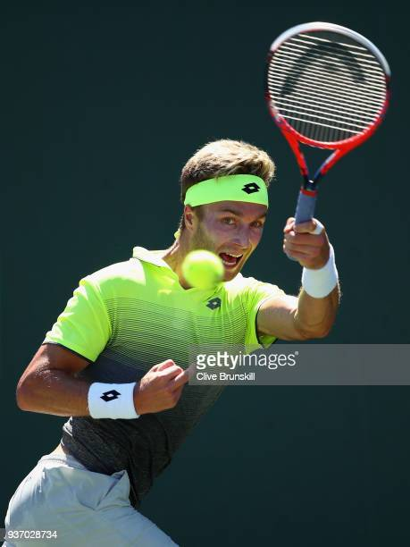 Liam Broady of Great Britain plays a forehand against Filip Krajinovic of Serbia in their second round match during the Miami Open Presented by Itau...
