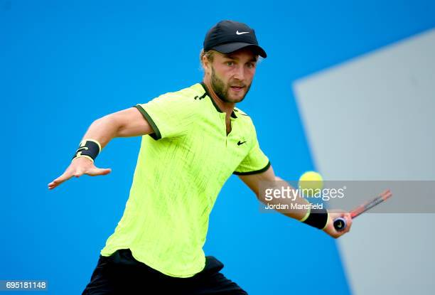 Liam Broady of Great Britain plays a forehand during his first round match against Illya Marchenko of Ukraine during day one of the Aegon Open at...