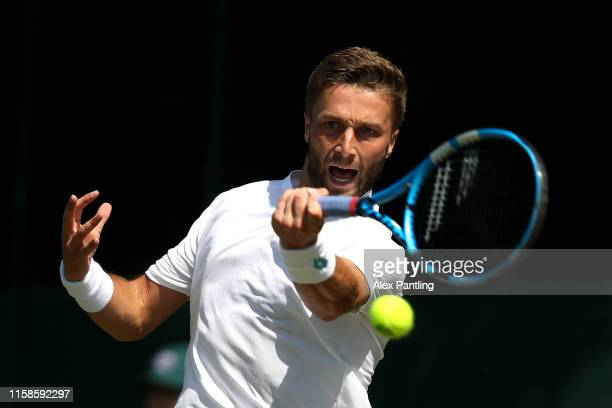 Liam Broady of Great Britain plays a forehand during his mens singles match against Gregorie Barrere of France during qualifying prior to The...