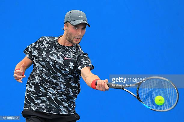 Liam Broady of Great Britain plays a forehand in his qualifying match against Jared Donaldson of the United States for the 2015 Australian Open at...