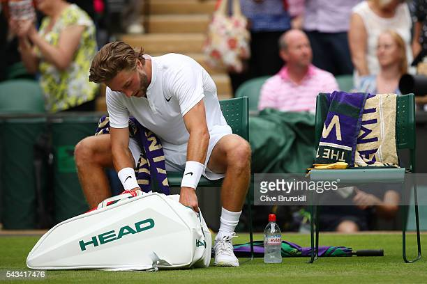Liam Broady of Great Britain prepares to leave the court following defeat in the Men's Singles first round match against Andy Murray of Great Britain...