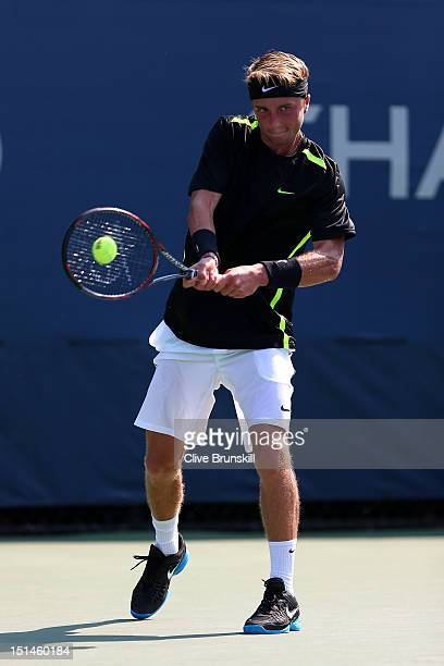 Liam Broady of Great Britain returns a shot during his boys' singles quarterfinal match against Wayne Montgomery of South Africa on Day Twelve of the...
