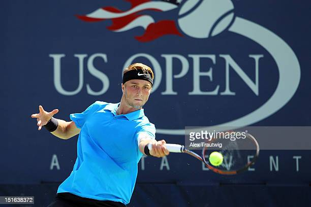 Liam Broady of Great Britain returns a shot during his boys' singles final match against Filip Peliwo of Canada on Day Fourteen of the 2012 US Open...