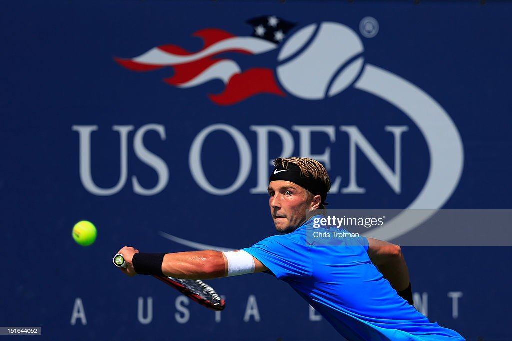 Liam Broady of Great Britain returns a shot during his boys' singles final match against Filip Peliwo of Canada on Day Fourteen of the 2012 U.S. Open at the USTA Billie Jean King National Tennis Center on September 9, 2012 in the Flushing neighborhood, of the Queens borough of New York City.