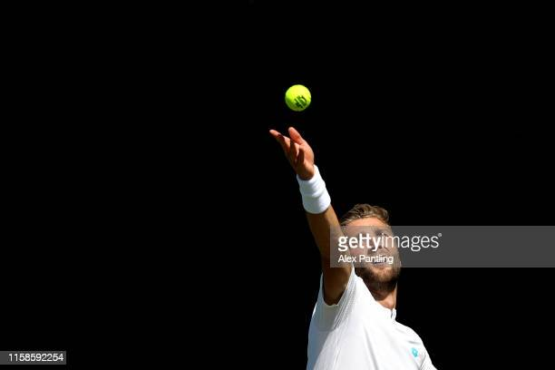 Liam Broady of Great Britain serves during his mens singles match against Gregorie Barrere of France during qualifying prior to The Championships...