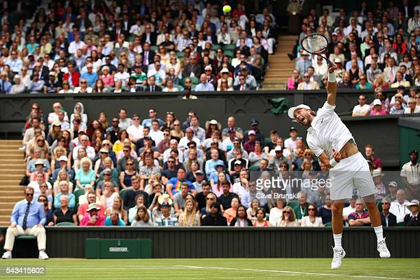 Liam Broady of Great Britain serves during the Men's Singles first round match against Andy Murray of Great Britain on day two of the Wimbledon Lawn...