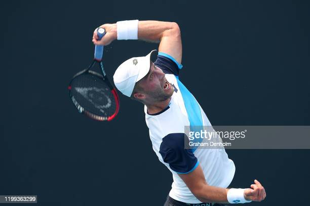 Liam Broady of Great Britain serves in his match against Ilya Ivashka of Belarus during 2020 Australian Open Qualifying at Melbourne Park on January...