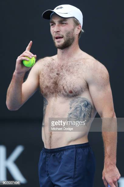 Liam Broady of Great Britain shows of his tattoo during a practice session ahead of the 2018 Australian Open at Melbourne Park on January 7 2018 in...