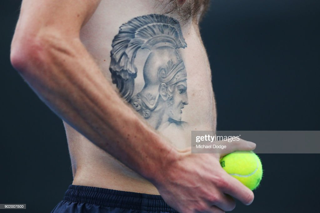 Liam Broady of Great Britain shows of his tattoo during a practice session ahead of the 2018 Australian Open at Melbourne Park on January 7, 2018 in Melbourne, Australia.