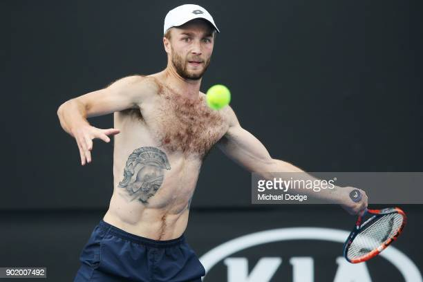 Liam Broady of Great Britain shows of his tattoos during a practice session ahead of the 2018 Australian Open at Melbourne Park on January 7 2018 in...