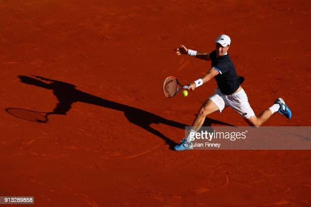 Liam Broady of Great Britain stretches for a backhand in his match against Albert RamosVinolas of Spain during day one of the Davis Cup World Group...