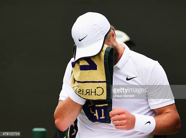 Liam Broady of Great Britain towels down between games in his Gentlemens Singles Second Round match against David Goffin of Belgium during day three...
