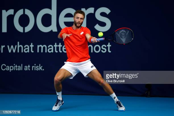 Liam Broady plays a forehand during his singles match against Kyle Edmund on day 4 of Schroders Battle of the Brits at the National Tennis Centre on...