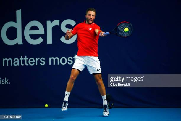 Liam Broady plays a forehand in his match against Andy Murray on day one of Schroders Battle of the Brits at the National Tennis Centre on June 23...