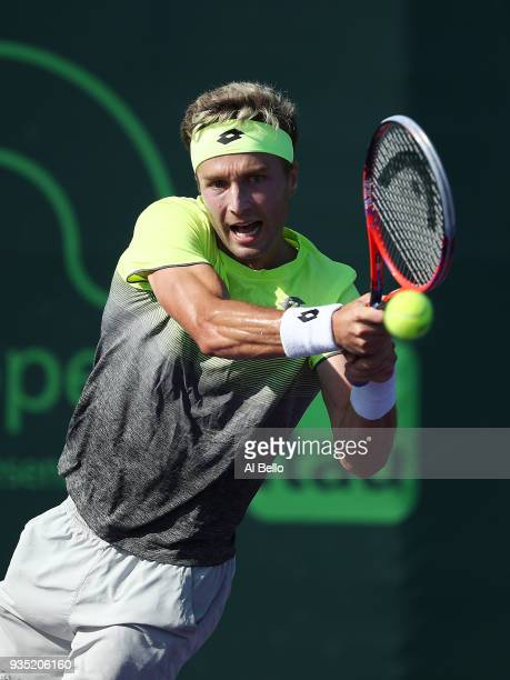 Liam Brody of Great Britain plays a backhand against Filip Peliwo of Canada during Day 2 of the Miami Open at the Crandon Park Tennis Center on March...